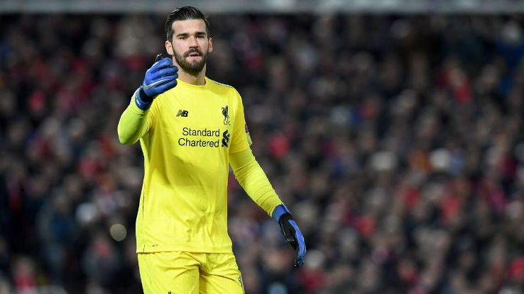 Alisson looks on during Liverpool's Champions League win over Napoli.