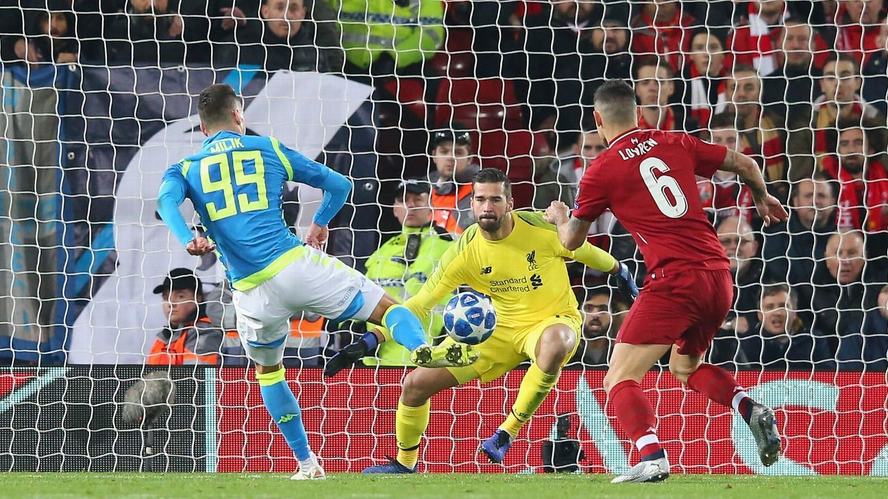 Alisson Becker of Liverpool makes a save from Arkadiusz Milik during a Champions League win against Napoli.
