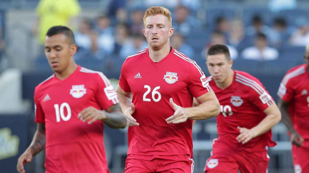 New York Red Bulls defender Tim Parker, center, signed a three-year deal to stay with the club.