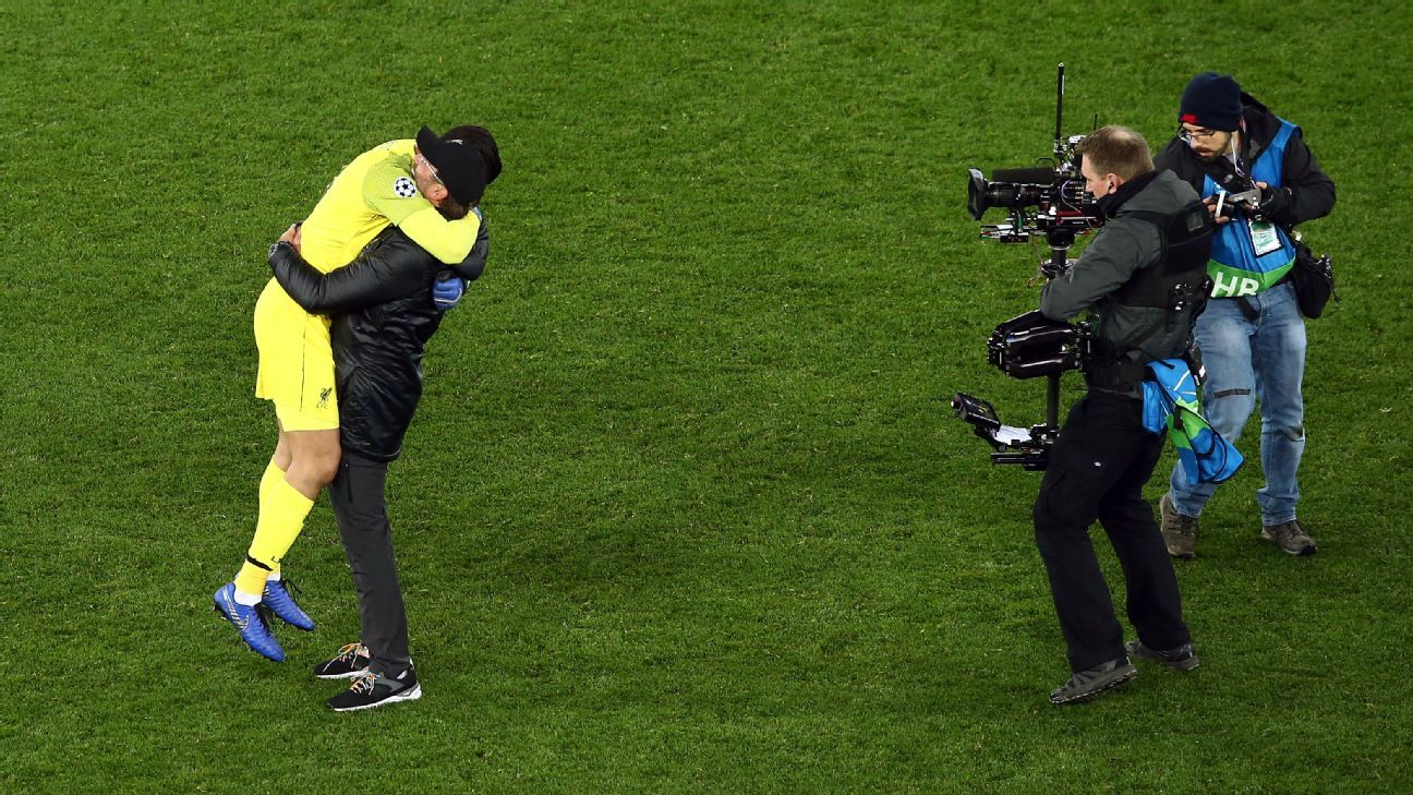 Liverpool manager Jurgen Klopp embraces Alisson Becker after the team's Champions League win against Napoli.