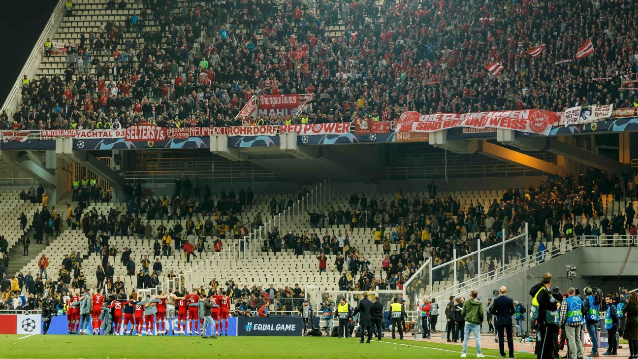 Bayern Munich players salute their away supporters after a Champions League win against AEK Athens.