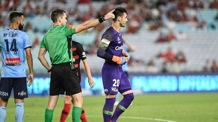 Referee Jarred Gillett instructs Vedran Janjetovic of Western Sydney Wanderers to leave the field