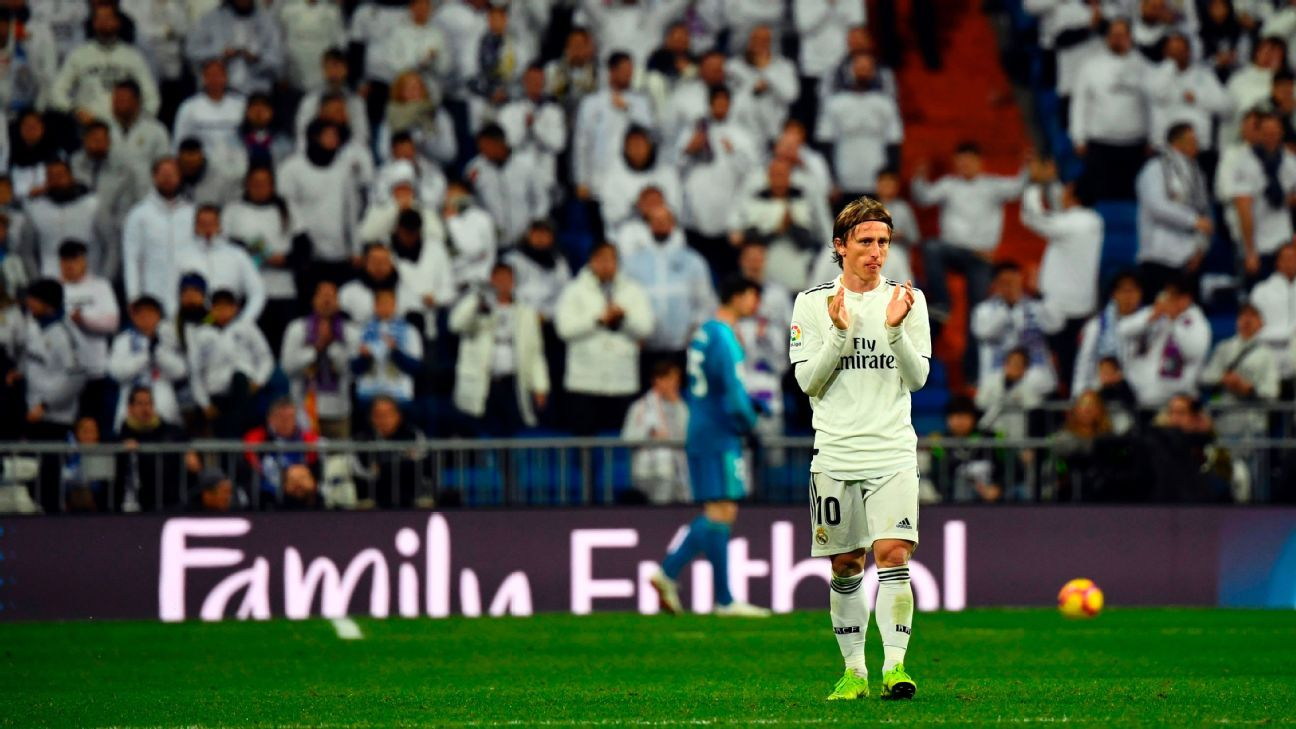Luka Modric applauds fans during Real Madrid's La Liga win over Rayo Vallecano.