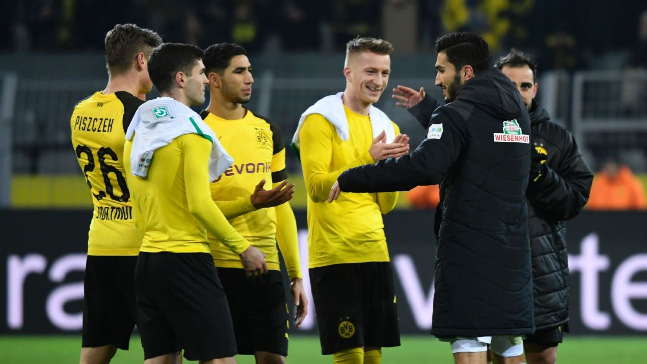 Former Dortmund midfielder Nuri Sahin, right, talks to his old teammates after their match with Werder Bremen.