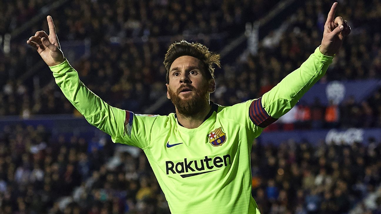 Lionel Messi celebrates after scoring in Barcelona's La Liga win over Levante.