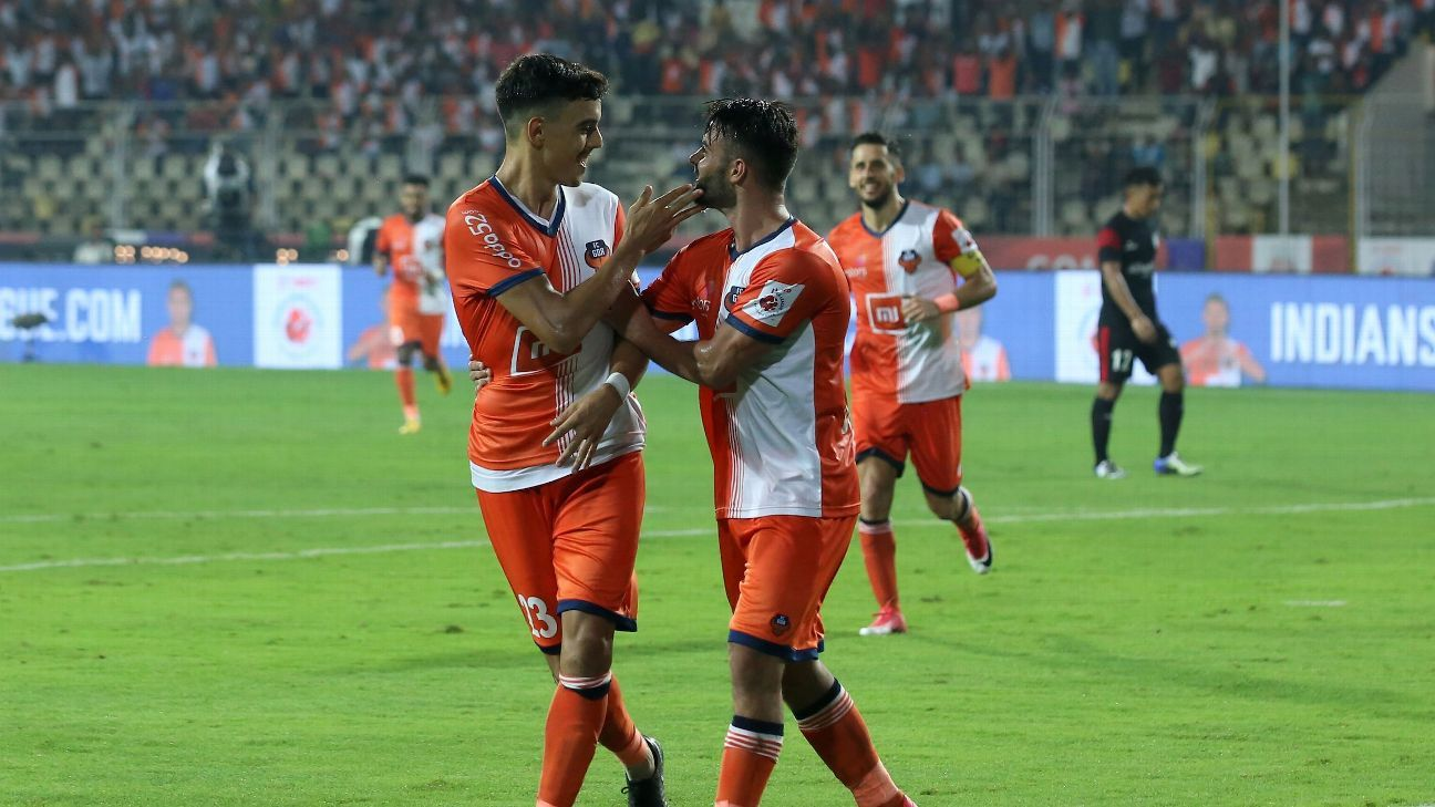 Edu Bedia (L) celebrates Goa's second goal against NorthEast.
