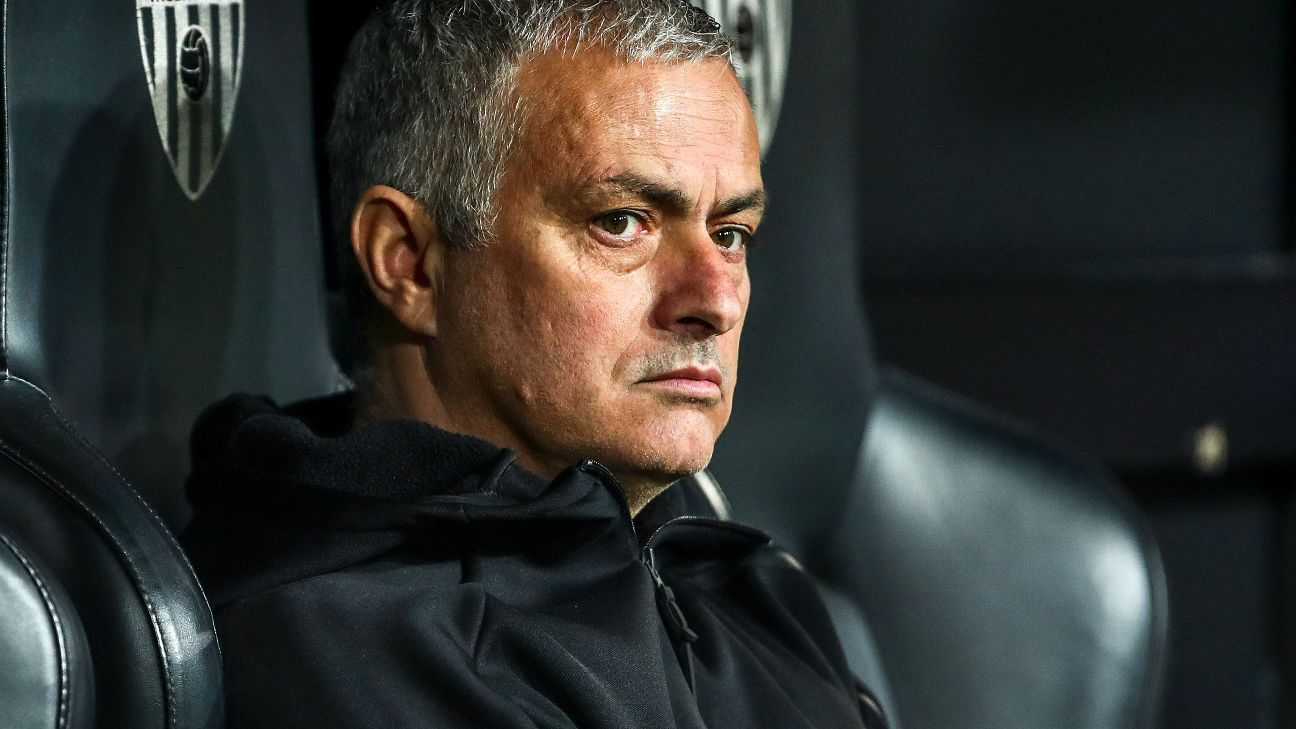 VALENCIA, SPAIN - DECEMBER 12: Jose Mourinho the head coach / manager of Manchester United sits in the dugout and watches the warm up prior to the UEFA Champions League Group H match between Valencia and Manchester United at Estadio Mestalla on December 1