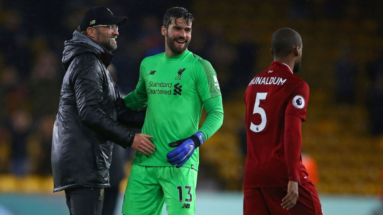 Liverpool manager Jurgen Klopp, left, celebrates with players after a win against Wolves.