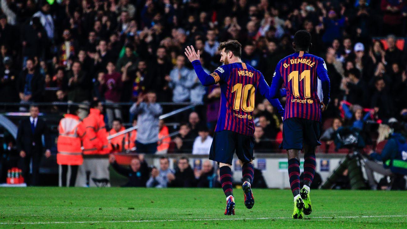 Lionel Messi, left, celebrates after scoring a goal for Barcelona against Celta Vigo.