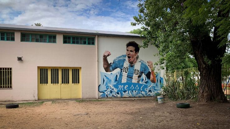 A mural of Lionel Messi dons the side of his childhood school, Escuela General Las Heras, in Rosario, Argentina.