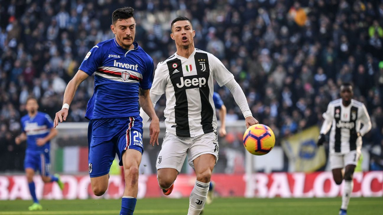 Sampdoria's defender Alex Ferrari runs forJuventus forward Cristiano Ronaldo close behind