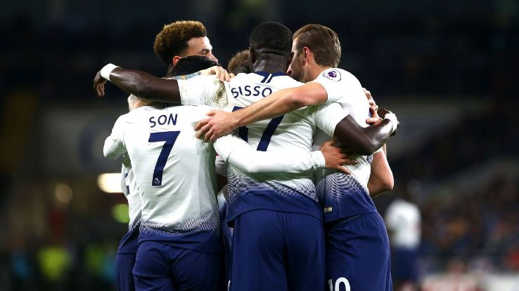 Tottenham players celebrate during their Premier League win at Cardiff City.