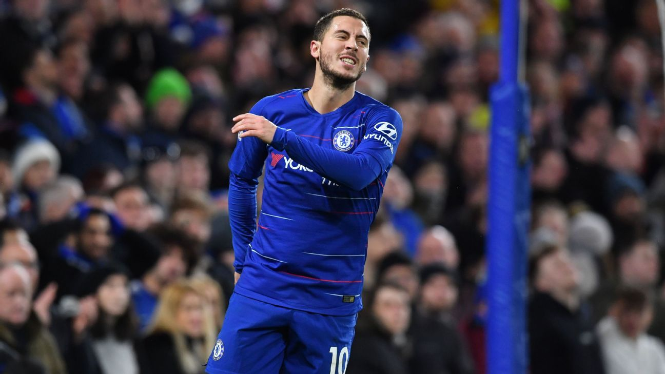 Chelsea's Belgian midfielder Eden Hazard reacts after missing a chance