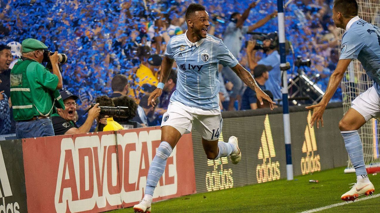 Khiry Shelton celebrates after scoring a goal for Sporting Kansas City in MLS.
