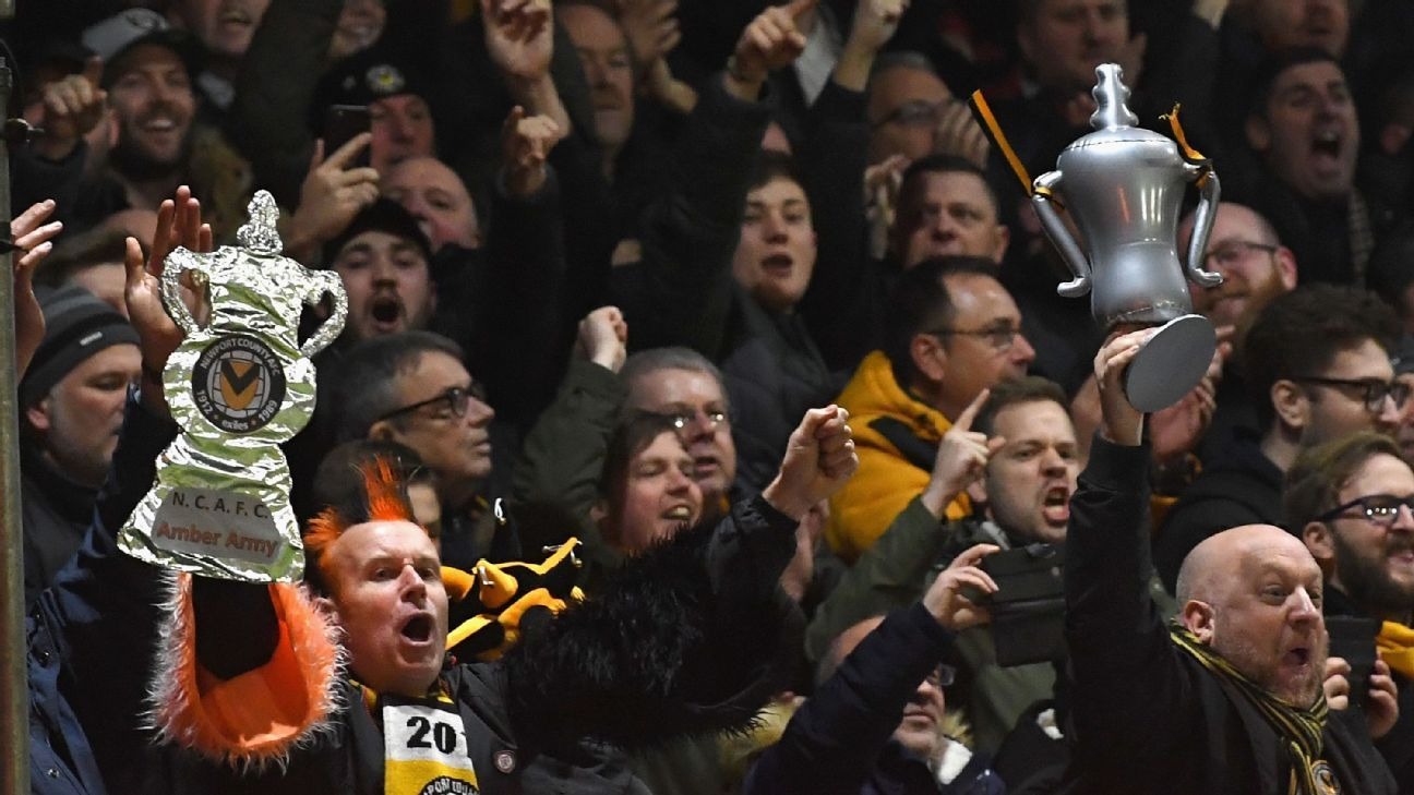 Newport fans celebrate the winning goal