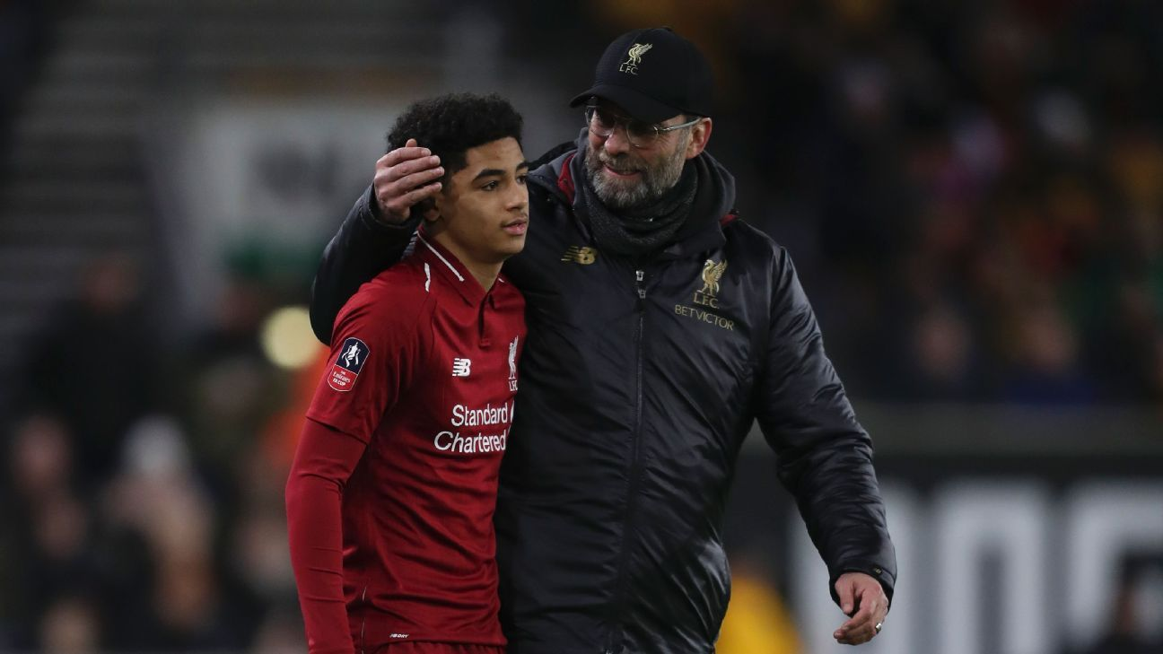 Jurgen Klopp, right, speaks with Ki-Jana Hoever after the 16-year-old made his debut for Liverpool in the FA Cup.