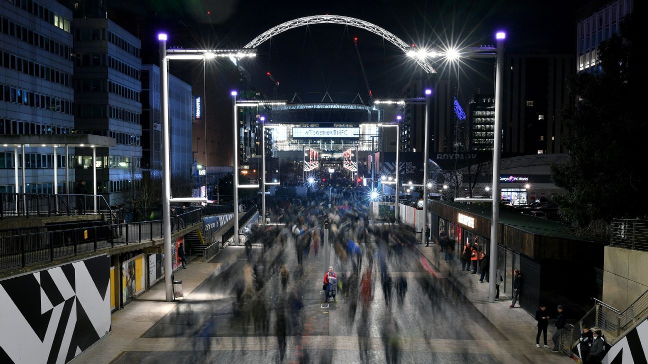 Fans head into Wembley Stadium ahead of the Carabao Cup match between Chelsea and Tottenham.