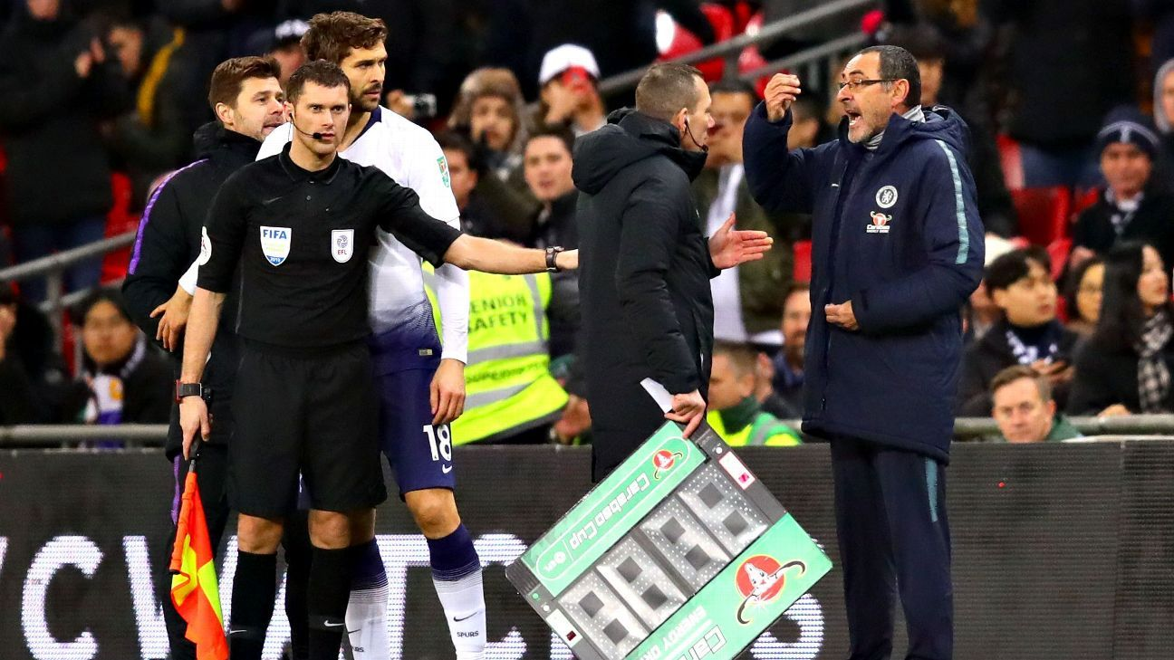 Chelsea manager Maurizio Sarri argues with the fourth official during his team's match against Tottenham.