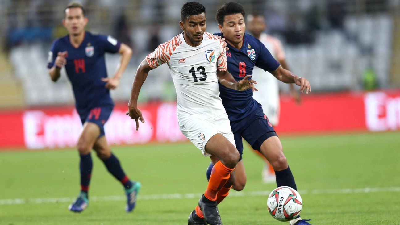 For Ashique Kuruniyan (centre), the Asian Cup game against Thailand was just his fourth start for India.