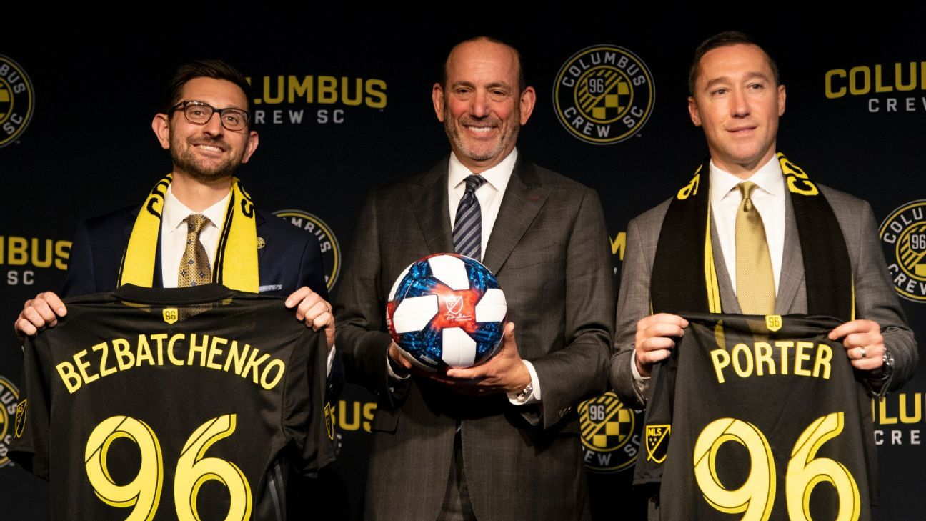 MLS commissioner Don Garber, center, with Columbus Crew head coach Caleb Porter, right, and president Tim Bezbatchenko.