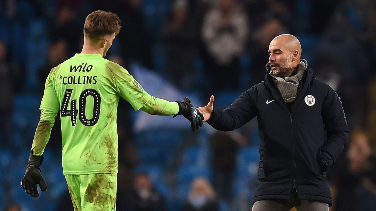 Man City manager Pep Guardiola talks to Burton Albion keeper Brad Collins after their Carabao Cup match.