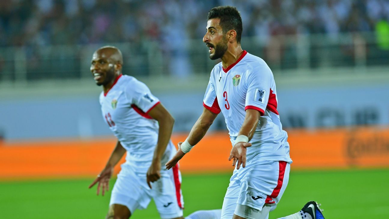 Jordan defender Tareq Khattab, right, celebrates after scoring a goal in his team's Asian Cup win against Syria.