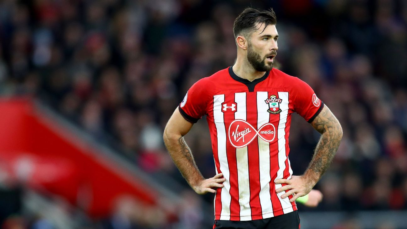 Southampton's Charlie Austin was handed a two-match ban for making an abusive gesture during their match with Man City.