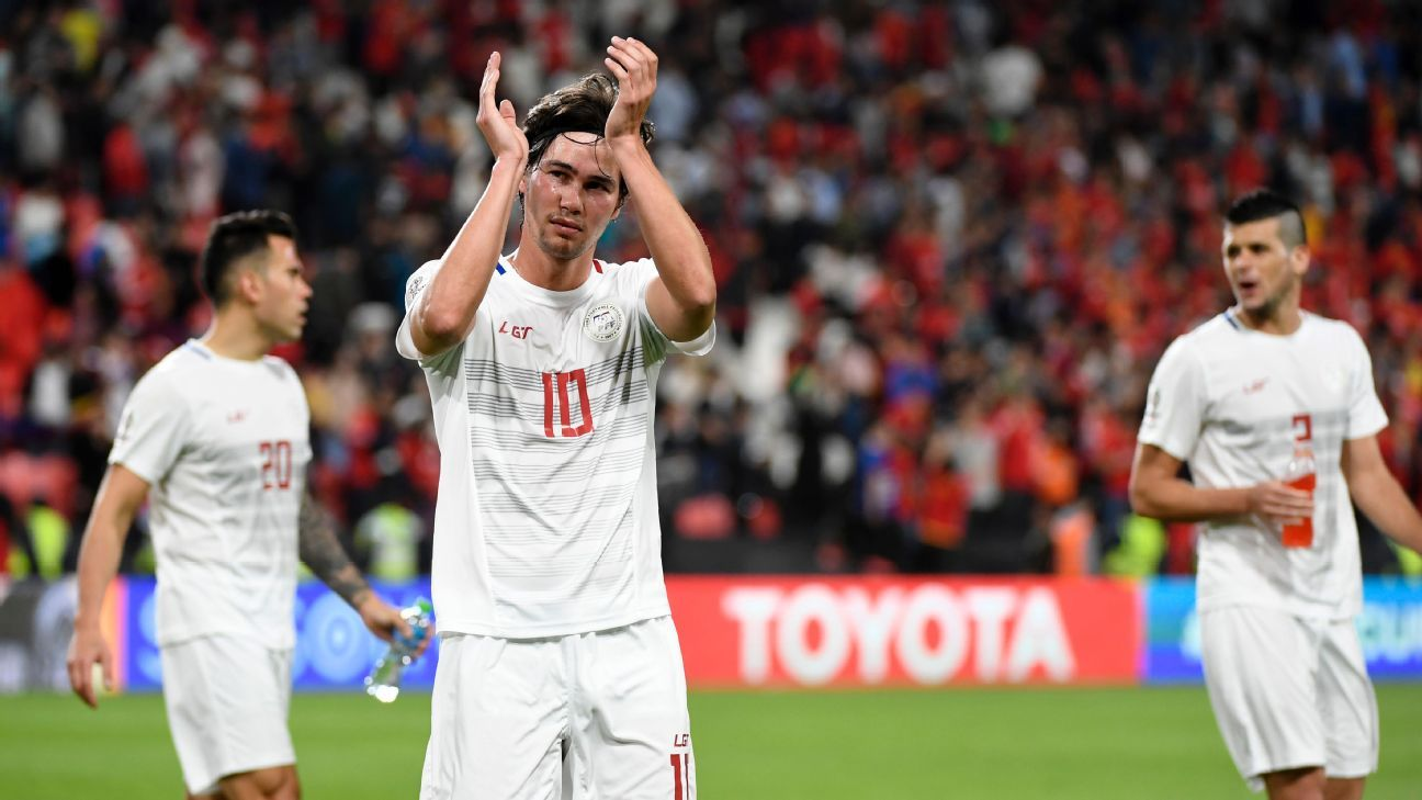 Philippines' forward Phil Younghusband applauds his team's supporters after an Asian Cup loss to China.
