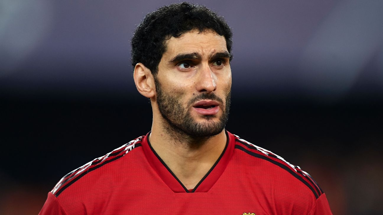 Marouane Fellaini looks on before Manchester United's Champions League match at Valencia.