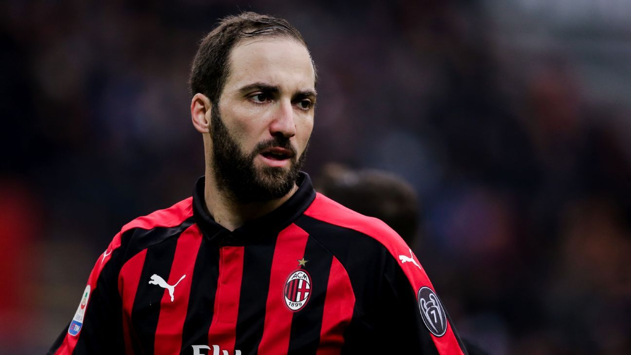 Gonzalo Higuain looks on during AC Milan's Serie A match against Fiorentina.