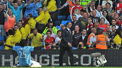 Emmanuel Adebayor celebrated in front of the Arsenal fans