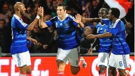 Gignac celebrates scoring for France.