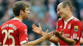 Arjen Robben toasts his Bayern Munich hat-trick with Thomas Mueller