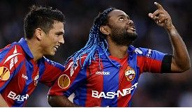 Vagner Love celebrates with Mark Gonzalez