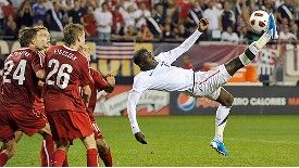 USA striker Jozy Altidore attempts the spectacular against Poland