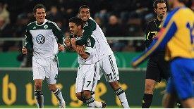 Josue of Wolfsburg celebrates his team's second goal