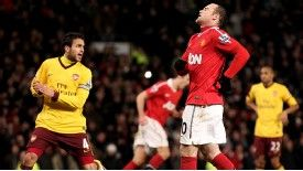 Wayne Rooney reacts after missing his penalty against Arsenal