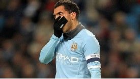Carlos Tevez shows his horror after missing from the penalty spot.