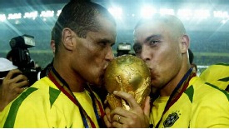 Rivaldo (l) wins the World Cup in 2002