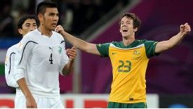 Australia's forward Robbie Kruse celebrates after scoring his team's sixth goal