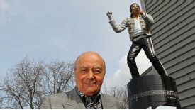 Mohamed Al Fayed stands in front of the Michael Jackson statue he unveiled in 2011