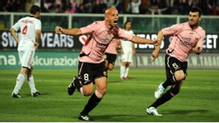 Palermo's Giulio Migliaccio celebrates after opening the scoring against AC Milan