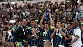 Inter Milan captain Javier Zanetti holds the Coppa Italia aloft after the Nerazzurri retain the trophy