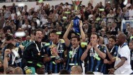 Inter Milan captain Javier Zanetti holds the Coppa Italia aloft after the Nerazzurri retain the trophy