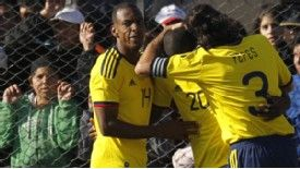 Colombia players mob goalscorer Adrian Ramos, whose goal turned out to be the winner