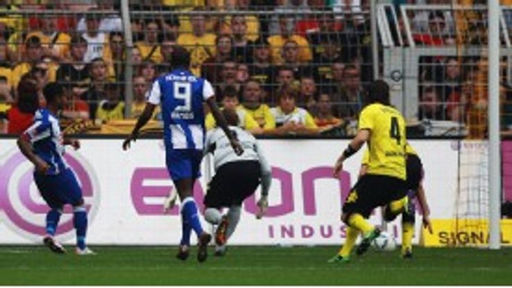 Raffael set Hertha Berlin on their way to a surprise victory at reigning champions Borussia Dortmund