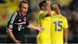 Bayern Munich defender Rafinha celebrates after scoring against Villarreal