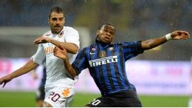 Roma's Simone Perrotta and Inter's Joel Obi battle for possession