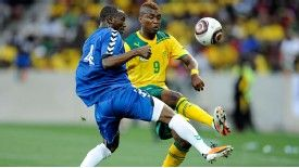 Mohamed Kamara of Sierra Leone vies for the ball with Katlego Mphela of South Africa