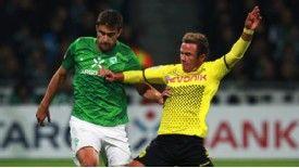 Werder Bremen's Sokratis is challenged by Borussia's Mario Goetze